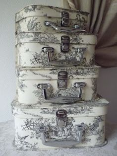 Oh my, want to find some vintage luggage and get some fabric and decoupage some of these from: Alice's Adventures in Wonderland: {Toile de Jouy}