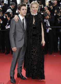 Film fans: Sienna Miller was joined by Xavier Dolan at the Cannes Film Festival premiere o...