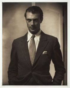 Gary Cooper in a black SB suit with tie and white pocket square