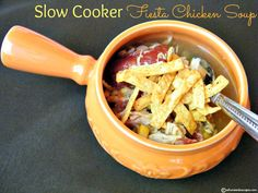 Slow cooker fiesta chicken soup - Ingredients      1 lb boneless chicken breasts     2 cloves garlic, minced     1/2 cup onion, diced     1/2 cup carrots, diced     1/2 cup corn     1 t oregano     1 t ground cumin     1 10 oz can Ro-tel Diced Tomatoes with Green Chilies     1 14.5 oz can chicken broth     1 lime, juiced     1 cup Salsa Verde (I used Herdez brand)