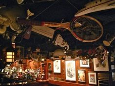 I saw this hanging from the ceiling of the '21' Club yesterday: one of tennis legend John McEnroe's broken racquets.  Yes, I really do want this.