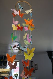 Twig and Toadstool: Butterfly Mobile... Love the butterflies. what if we melted crayons in wax paper and then cut out the butterflies from that? I think younger ones would love this.