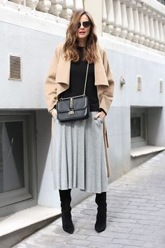 cashmere camel coat, grey midi skirt, black jumper and boots