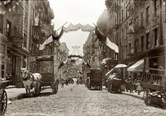 "Italian Festa: 1908 New York, May ""Italian festa. Mott Street decorated for religious feast."" 166 Mott St to left of white horse. New York Pictures, Old Pictures, Old Photos, Vintage Photos, Little Italy New York, Photo New York, The Bowery Boys, San Gennaro, Mott Street"