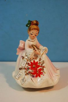 Vintage Josef Originals musical figurine of a lady writing Christmas cards. From my personal collection.