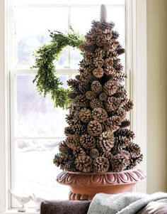 What a great rustic decoration for the holidays using pine cones. Is this what you mean @Megan Rader??