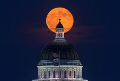 "Blue Moon (2015-07-31) over state capitol, Sacramento CA. It was the second full Moon in July. When the Moon is low in the sky you often get a red or orange color. (Credit: David Yu) Mona Evans, ""Once in a Blue Moon"" http://www.bellaonline.com/articles/art181400.asp"