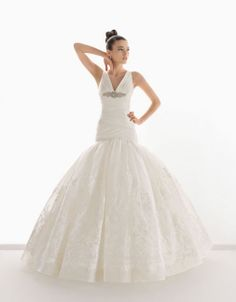 it's like Jennifer lawrence's dress from the oscars! Pretty sleeveless ball gown floor length wedding dress