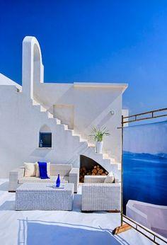 Deep blue and white will take you away to Mykonos, Greece.  Mediterranean patio by Elad Gonen & Zeev Beech