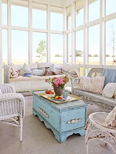 Sunroom windows - Employ an old trunk as a coffee table, and you'll get two for the price of one. Not only is it a coffee table, it's the perfect storage spot for stashing blankets, games, and living room extras. Sunroom Furniture, Wicker Furniture, Shabby Chic Furniture, Vintage Furniture, Furniture Ideas, Furniture Stores, Modern Furniture, European Furniture, Leather Furniture