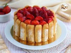 When strawberries are showing up, what is nicer than to bake a pretty charlotte? - Recipe Dessert : Strawberry charlotte by PetitChef_Official Charlotte Dessert, Mexican Food Recipes, Sweet Recipes, Cake Recipes, Dessert Recipes, Food Cakes, Charlota Cake, Beaux Desserts, French Dishes