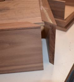 Mix several types of joinery to make a complicated joint. The example below has miters, a locked joint and a dado.