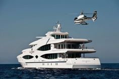 Multi-million dollar mega Yacht with a helicopter pad