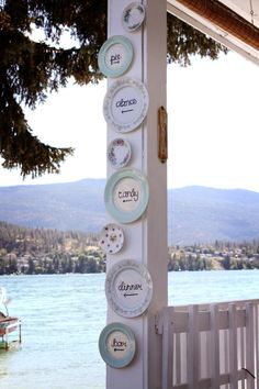 Use plate hangers and dry erase markers, hang on wood doors. Directional signs on vintage china. Photography by camilliacourts.com