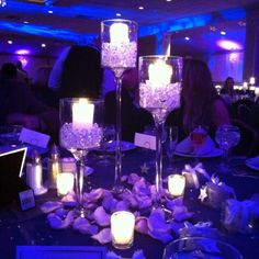 Cool idea for center piece purple water gems and candles