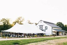 Cocktail hour and reception in barn and tent | Photo: Perry Vaile | Planning/Design: Leigh Pearce Weddings