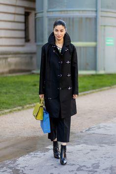 Caroline Issa wearing a black coat outside Chloe on March 2 2017 in Paris France