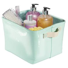 """mDesign Vegan Patent Leather Bathroom Vanity Organizer Bin for Towels, Shampoo, Conditioner, Cosmetics, Beauty Products - Medium, Mint/Gold. Waterproof storage bin with easy-carry handles. Organizes towels, shampoo and lotion bottles, cosmetics, toiletries and other vanity or beach essentials. Ideal for back-to-campus, college dorms, teen bathrooms, spas, beaches and pools, guest bathrooms or everyday use. Made of vegan patent leather. 12.5"""" x 10.25"""" x 8.25""""."""