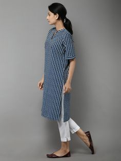 Description: It's a printed kurta with slit at the neck. Pair it up with off white fitted trousers. Size Chart (In inches) - S - Chest : Waist (Relaxed) : Kurta Designs Women, Kurti Neck Designs, Salwar Designs, Blouse Designs, Fashion Pants, Fashion Outfits, Kurta Style, Indian Designer Suits, Kurti Designs Party Wear