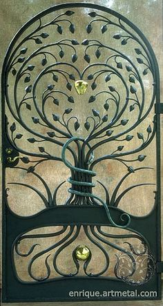 "Gorgeous work of art in a wrought iron gate - titled ""Tree of Knowledge"" by Enrique Vega :: The gate is made of hand forged steel with a painted graphite finish. The apple and seed pods were hand raised from soft brass - a technique used to cold form objects using repeated blows with specialized hammers and stakes. The serpent was hot forged from 1"" solid copper bar and finished with a Verde patina."