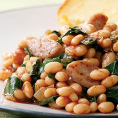 Turn baked beans into an easy main dish by adding chicken sausage and collard greens. Check the sodium amount on your canned beans to make sure it's not too high. Giving the beans a good rinse before adding them to the recipe can shed up to 35 percent of sodium.   Recipe: BBQ Baked Beans and Sausage   - Delish.com