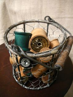 spools in a chicken-wire basket; more favorites of mine!