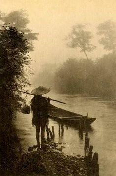 "Hard to believe this is a photograph!  Looks like a hand-inked illustration...  ""FISHERMAN AND SKIFF ON THE RIVER OF MIST"" by Okinawa Soba.. This image is one of several examples of a largely ignored facet of old Japanese Photography -- a genre called ""TAISHO PICTORIAL PHOTOGRAPHY"". The pictorialism movement in Japan reached its peak during the reign of EMPEROR TAISHO (1912-26)."