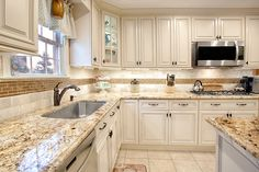 Classy decorative touches that you crave in a kitchen space with a timelessly elegant design - beautiful Fabuwood Wellington Ivory kitchen cabinets. Fabuwood Cabinets, Ivory Kitchen Cabinets, Kitchen Redo, Home Decor Kitchen, Kitchen Interior, Home Kitchens, Kitchen Design, Antique White Cabinets, Kitchen Ideas