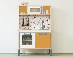 """The popular IKEA DUKTIG play kitchen is an absolute classic among all the children's kitchen models. With the sticker set """"TRIANGLIG"""" it gets an Ikea Tjusig, Ikea Kids Kitchen, Toy Kitchen, Kitchen Furniture, Furniture Decor, Play Kitchen Accessories, Ikea Toys, Childrens Kitchens, Kitchens"""
