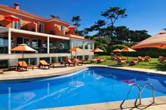 Main Building with pool and the sea view by day.  #destinationweddingsinportugal #weddingdestinationinportugal #weddingvenuebytheseaportugal #casamentohotelsenhoradaguia #casamentoportugal