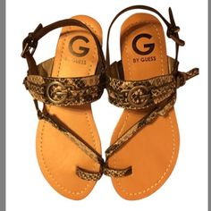G BY GUESS SNAKE SANDALS NWOT These summertime sandals feature a fashionable toe loop, adjustable straps for a custom fit, and attractive logo detail. Simple styling and subtle detail make the G by Guess snake Lankas a must have for the season! Smooth strap lining 1/4 inch heel Strap with logo hardware detail Unique toe loop Faux leather upper Treaded outsole for traction Open toe front Lightly cushioned footbed Side stretch panel for easy on wear Adjustable straps for a custom fit G by…