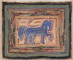 "Realized Price: $4029   American hooked rug depicting a blue prancing horse within multiple line borders, late 19th c., 36"" x 43""."