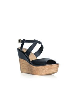 The Sammie - Give yourself a lift in this strappy wedge.  The partially covered heeled adds an interesting twist to a warm weather classic.