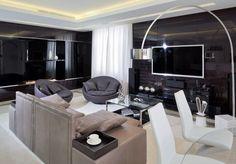 modernes Wohnzimmer in dunklen Nuancen mit Deckenbeleuchtung