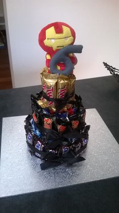 Chocolate bar cake. Iron man topper. 6th wedding anniversary present - iron and candy!