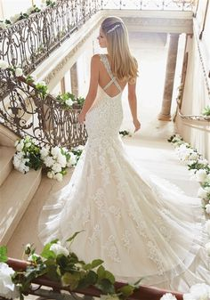 2016 Elegant #Wedding Dress. Beaded Alencon Lace & English Net Fit and Flare Mermaid Gown with an Illusion Lace Crystal Beaded V-Neckline Over Sweetheart Interior, Beaded Lace Tank Straps, Sequin Lace Fitted Bodice Past Hips, Scattered Sequin Lace Applique Fit & Flare Mermaid Skirt, Chapel Train, Crystal Beaded Straps Criss-Cross in Back with Low V-Back and Covered Buttons. #crystals #laceweddingdress #mermaid #fitandflare #tulle #gorgeous #bridalgown #bride #sayyesto #customweddingdresses