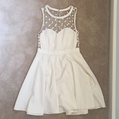 Urban Outfitters Ivory Dress with Polka Dot This white/ivory dress is very slimming and has beautiful polka dot detailing. The cut of the dress creates a classic look while the sheer neckline and polka dots add a retro feel. It is in wonderful condition. Urban Outfitters Dresses Midi