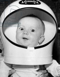 Baby boy Neil Carlin wearing astronaut helmet: He was born just as US Apollo 11 astronaut Neil Armstrong stepped onto the Moon July 21, 1969. His mom decided to mark the occasion by naming him after Armstrong. (vintage photo)