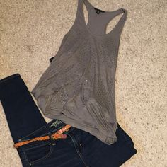 Adorable dressy tank Gray oversized tank with studs. Can fit an extra small or small. Can be dressed up or down. I washed this shirt but never got the chance to wear it. Banana Republic Tops Tank Tops