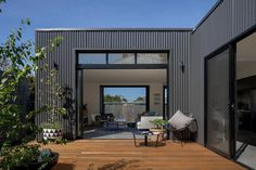 Use of colourbond cladding in black, with black windows and deck from the Brunswick Extension House Cladding, Exterior Cladding, Facade House, Shed Homes, Prefab Homes, Modular Homes, Metal Building Homes, Metal Homes, Building A House