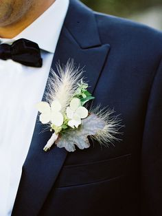Hydrangeas, leaves, and feathers brought a soft touch to this lapel.