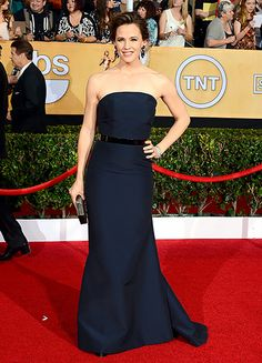 Jennifer GarnerThe presenter wore a strapless, navy silk bustier gown by Max Mara with a gunmetal belt. She paired her dress with a Ferragamo clutch for an overall classy simple look.