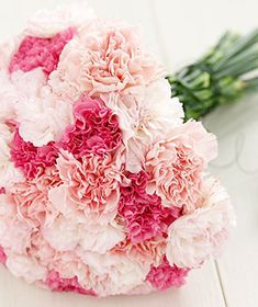 For the bridesmaids a simple carnation bouquet with blush and white colours. Like this but without the bright pinks.