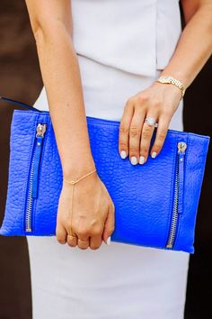 Love the pop of color with this electric blue Vince Camuto clutch.  I NEED this color!!!!!