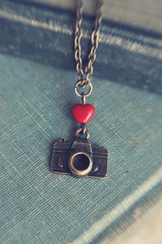 I heart my camera necklace.