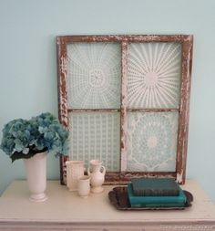 Lace or doilies in old window frame. Photo only.