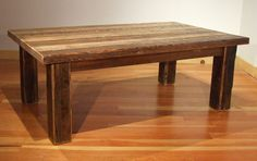 I think this is the perfect old barn wood coffee table!  Perfect mix of rough and clean.