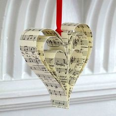 Handmade Sheet Music Christmas Decoration Good idea for my old song book that has fallen to bits from the spine! The post Handmade Sheet Music Christmas Decoration appeared first on Paper Diy. Paper Christmas Decorations, Paper Christmas Ornaments, Christmas Hearts, Christmas Fun, Vintage Christmas, Christmas Sheet Music, Craft Decorations, Christmas Carol, Homemade Christmas