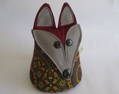 IHeartStitchingSA on Etsy Fox doorstop Shwe-shwe fabric White Leaf, Blue And White, Geometric Owl, Doorstop, Fox Pattern, Owl Patterns, Cute Designs, Sunglasses Case, African