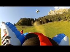 GoPro: Close Encounters - Proximity Flying With Jokke Sommer - YouTube Shot 100% on the HD HERO® cameras from http://GoPro.com.  Jokke Sommer and friends navigate the mountains of Hintisberg, Switzerland in their wingsuits.